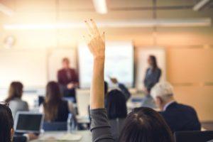 Raised hand in Seminar